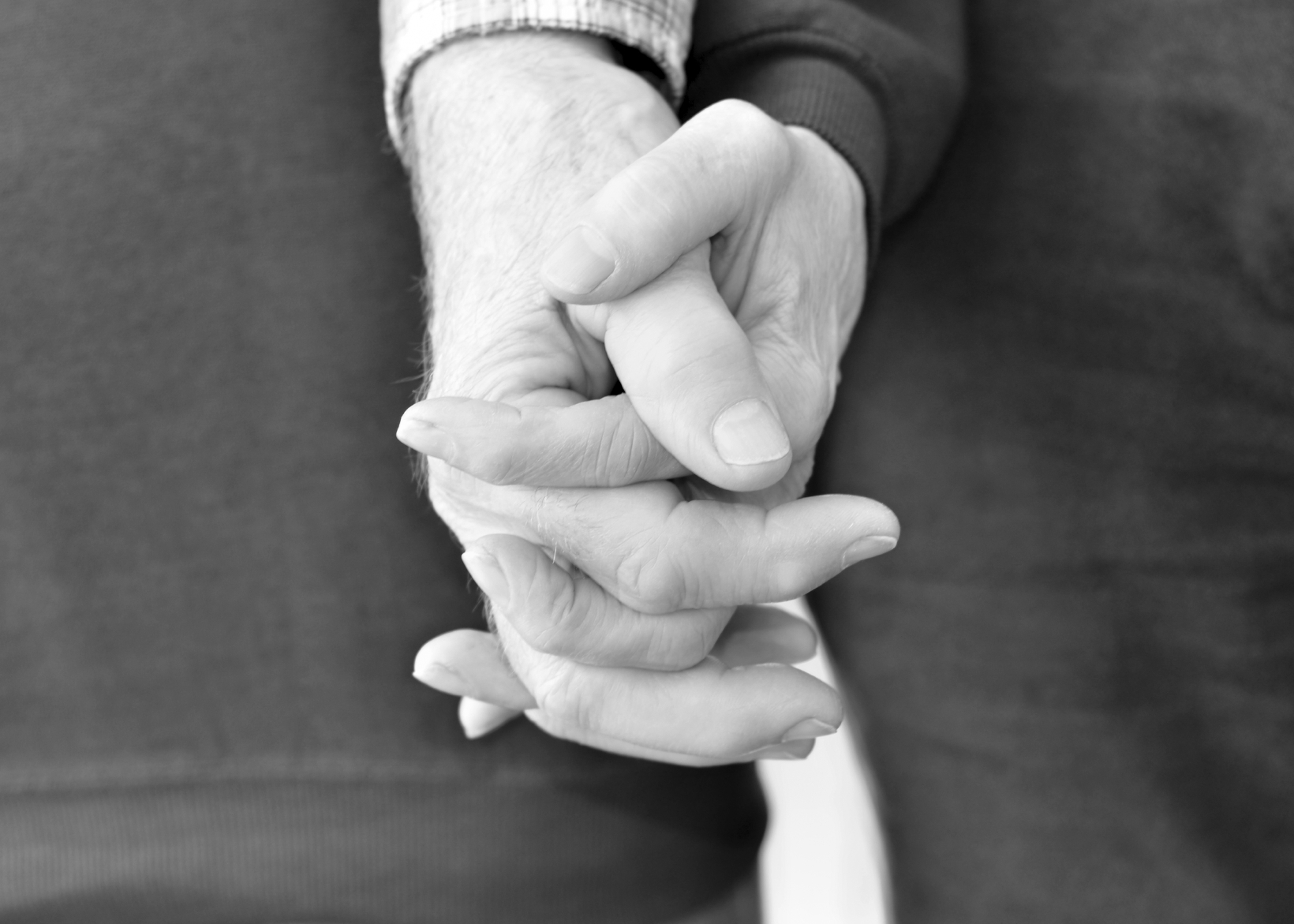 Istock photo elderly couple holding hands